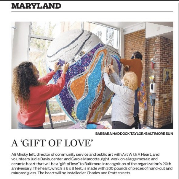Ali Mirsky and volunteers work on The Heart of Baltimore sculpture in a photo the appeared in the Baltimore Sun